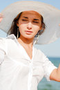Portrait beautiful young woman white hat enjoying sunny day beach outdoors Royalty Free Stock Photo