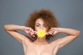 Portrait of beautiful young woman with yellow flower in mouth Royalty Free Stock Photo