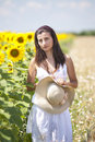 Portrait of a beautifull girl near sunflower field Stock Photo
