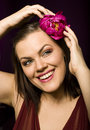 Portrait of beauty brunette woman with flower in her hair close up Royalty Free Stock Photo