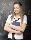 Portrait of beauty happy student with books near blackboard Royalty Free Stock Photo