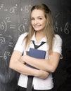Portrait of beauty happy student with books near blackboard Royalty Free Stock Photo