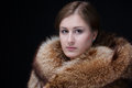 Portrait of beauty lady good looking young woman in luxury winter fur mink coat shot in studio on black background Stock Photo