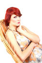 Portrait of beauty red hair female model sitting Stock Photography