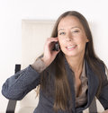 Portrait of beauty sexy business lady talking on phone and smiling close up Royalty Free Stock Photo