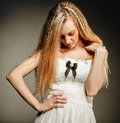 Portrait of the beauty young blond girl in white dress with make up Royalty Free Stock Images