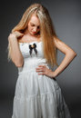 Portrait of the beauty young blond girl in white dress with make up Stock Image