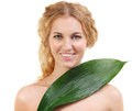 Portrait of the beauty young blond woman with green leaf isolated on white Royalty Free Stock Photography