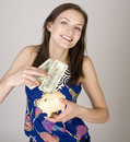 Portrait of beauty young woman with moneybox isolated and cash on white Royalty Free Stock Photo