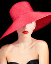 Portrait of a beutiful lady in red hat with lips Royalty Free Stock Photography