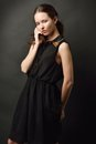 Portrait of the beutiful woman in a black dress she was shooted studio with dark background Royalty Free Stock Image