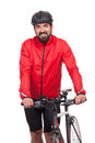 Portrait of bicyclist with helmet and red jacket, posing next to a bicycle, isolated on white Royalty Free Stock Photo