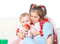 Portrait of a big sister feeds the younger apple fruit health love Royalty Free Stock Photography