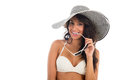 Portrait of black woman in white bikini with straw hat Royalty Free Stock Photo
