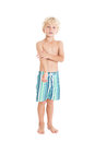 Portrait of a blond boy wearing swimming shorts studio shot isolated on a white background Royalty Free Stock Photo