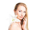 Portrait of a blond woman with a lily flower beauty young attractive fresh healthy and natural isolated on white Stock Photography