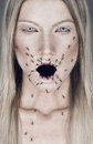 Portrait of blond woman with open mouth and ants