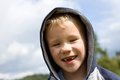 Portrait of blonde boy little with hood and smile Royalty Free Stock Photography