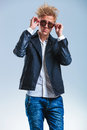 Portrait of blonde skinny man wearing jeans and leather jacket Royalty Free Stock Photo