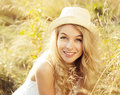 Portrait of blonde woman at summer field happy meadow Stock Photo