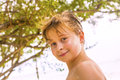 Portrait of a boy with blonde hair at the beach smiling Royalty Free Stock Photo