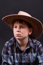 Portrait of a boy in a cowboy hat Stock Photos