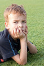 Portrait of a boy on the football field. Royalty Free Stock Images