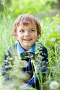 Portrait of boy sitting on grass in park Royalty Free Stock Images