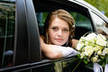 Portrait bride in a car window Royalty Free Stock Photography