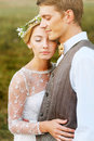 Portrait of the bride and groom close-up with closed eyes. Rustic style Royalty Free Stock Photo