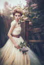 Portrait of a bride in a white dress with flowers in retro style. Royalty Free Stock Photo