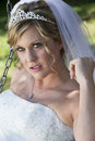 Portrait of bride young blonde in white wedding dress with veil pulled back and a tiara Royalty Free Stock Photo