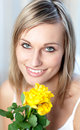 Portrait of a bright woman holding yellow roses Royalty Free Stock Images