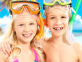 Portrait of the brother with sister closeup happy enjoying at beach laughing children standing together in swimwear swimming Stock Images