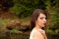 Portrait brunette caucasian woman white dress forest Stock Images