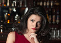 Portrait of brunette girl at a bar Royalty Free Stock Image
