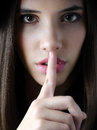 Portrait of brunette girl showing silence hand gesture the beautiful Stock Photo