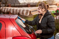Portrait of brunette woman washing red car outdoor closeup Stock Image