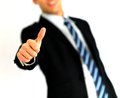 Portrait of business man giving thumbs-up Stock Photography