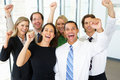 Portrait of business team in office celebrating and smiling to camera Stock Photos