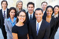 Portrait of business team outside office smiling to camera Stock Images