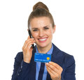 Portrait of business woman with credit card talking cell phone Stock Photos