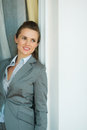 Portrait of business woman leaning on jamb Stock Photos