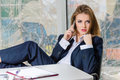 Portrait of business woman in man s suit on mobile phone at her office fashion styled girl shirt talking Royalty Free Stock Photo