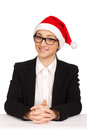 Portrait of business woman in santa hat Stock Image