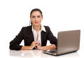 Portrait of business woman sitting on her desk Stock Image