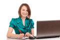 Portrait of business woman sitting on her desk Royalty Free Stock Image