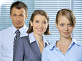 Portrait of businessman and businesswomen smiling in office Royalty Free Stock Photo