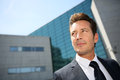 Portrait of businessman in front of modern building Royalty Free Stock Photo
