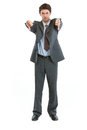 Portrait of businessman showing thumbs down Royalty Free Stock Image